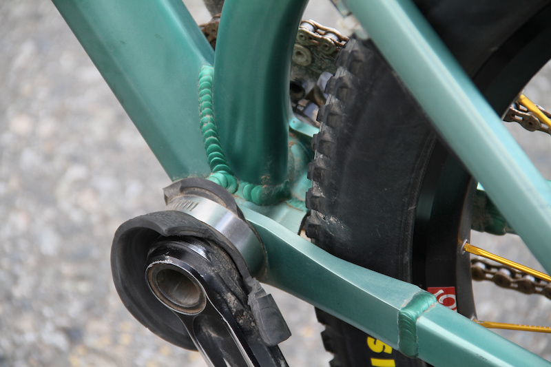 A clever arrangement of machined pieces and tubing allows the rear wheel to be tucked in extremely close to the bottom bracket shell.